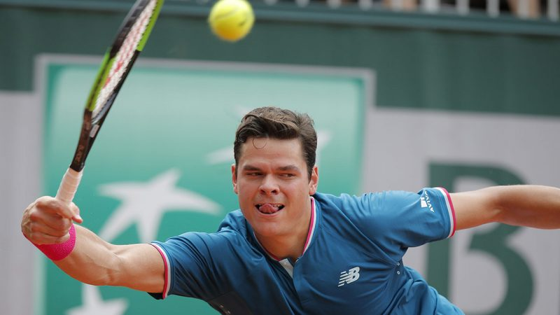 Canada's Milos Raonic plays a shot against Spain's Guillermo Garcia-Lopez during their third round match of the French Open tennis tournament at the Roland Garros stadium, in Paris, France. Friday, June 2, 2017. (AP Photo/Michel Euler)