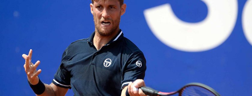 Slovakia's Martin Klizan returns the ball to Serbia's Novak Djokovic during their Barcelona Open ATP tournament tennis match in Barcelona on April 25, 2018. (Photo by Josep LAGO / AFP)        (Photo credit should read JOSEP LAGO/AFP/Getty Images)
